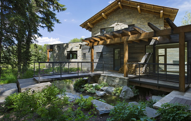 contemporary-stone-farmhouse-with-aged-wood-siding-segments-6-bridges.jpg