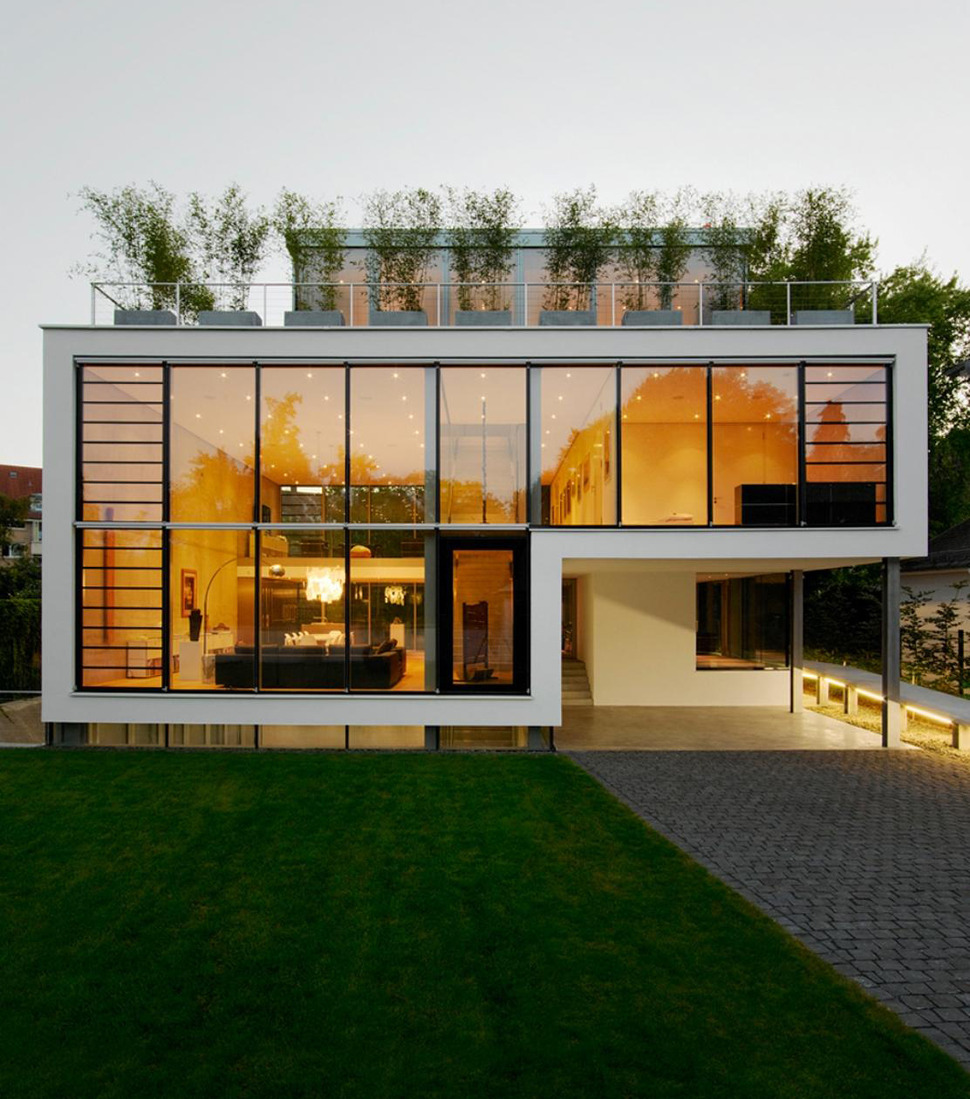 Energy optimized house with roof terrace louver windows for Terrace of the house