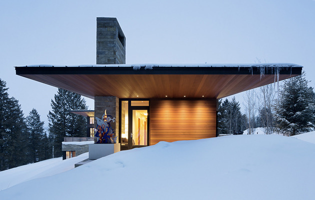 house-artist-studio-softly-curving-roofline-8- stone-wood.jpg