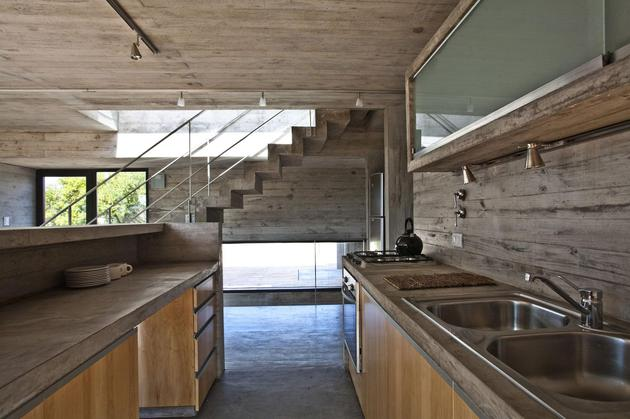 low-maintenance-concrete-beach-house-10-kitchen.jpg