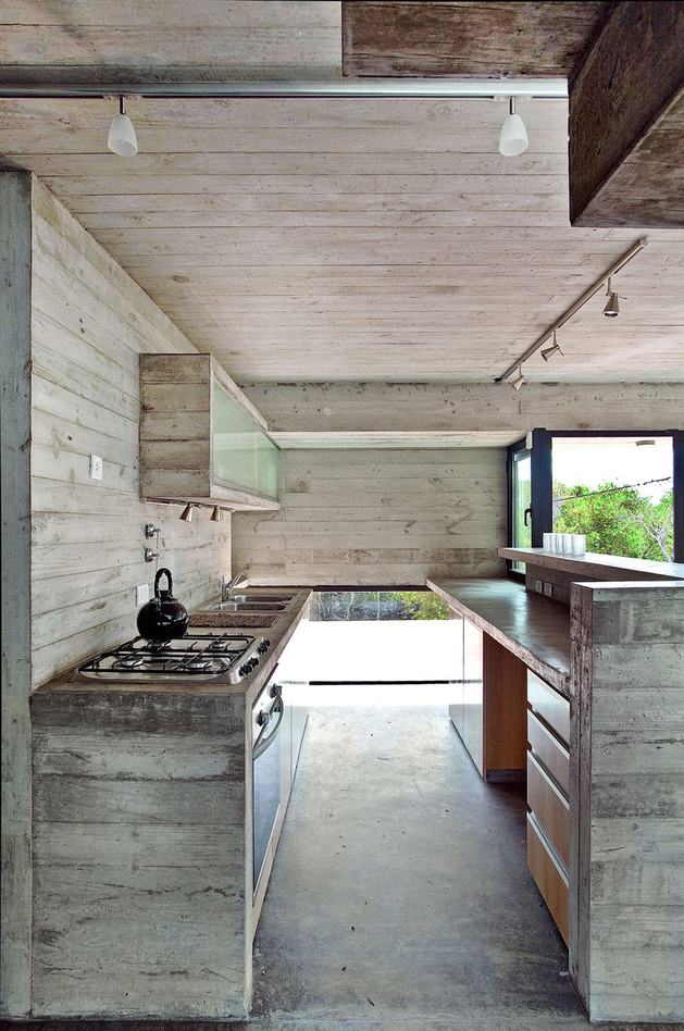 low-maintenance-concrete-beach-house-11-kitchen.jpg