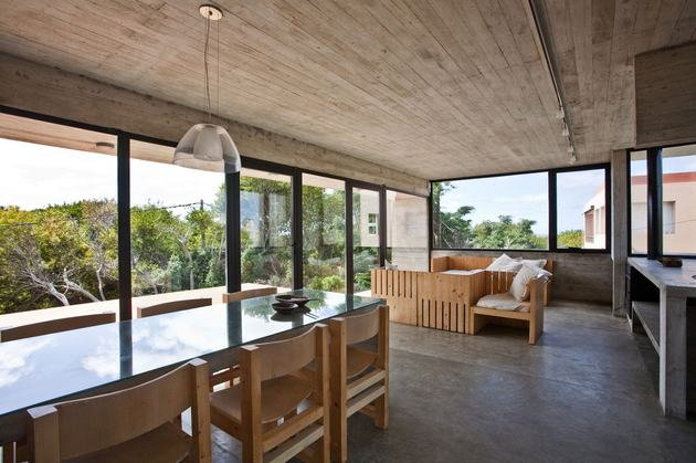 low-maintenance-concrete-beach-house-14-dining.jpg