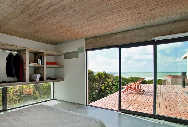 low-maintenance-concrete-beach-house-19-master-bed.jpg