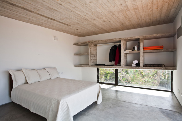 low-maintenance-concrete-beach-house-20-master-bed.jpg