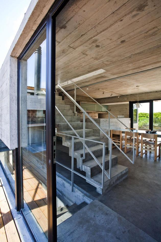 low-maintenance-concrete-beach-house-7-stair-landing.jpg