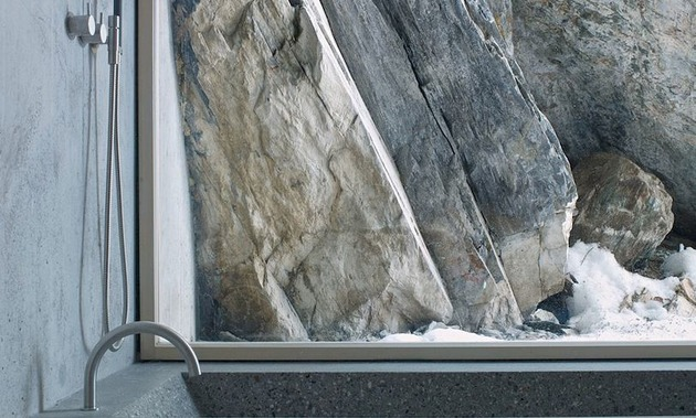 minimalist-concrete-alpine-cabin-7-window-rocks.jpg