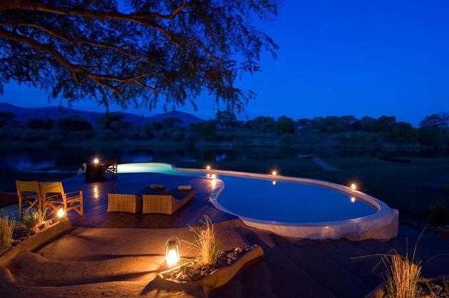 organic-holiday-home-overlooks-2-rivers-pool-4-pool-night.jpg