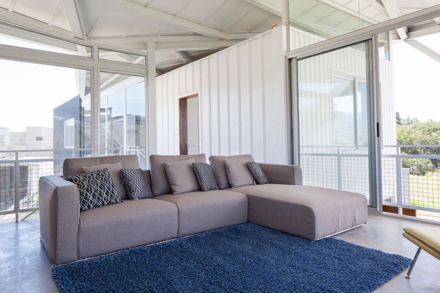 outdoor-living-house-under-geometric-canopy-12-living-room-couch.jpg