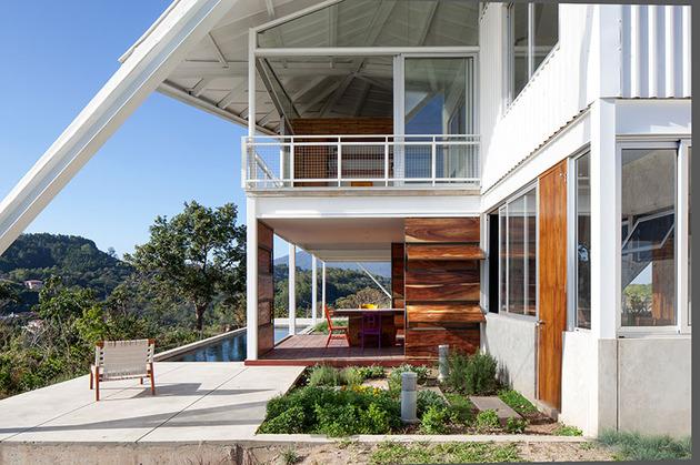 outdoor-living-house-under-geometric-canopy-7-rear-deck.jpg