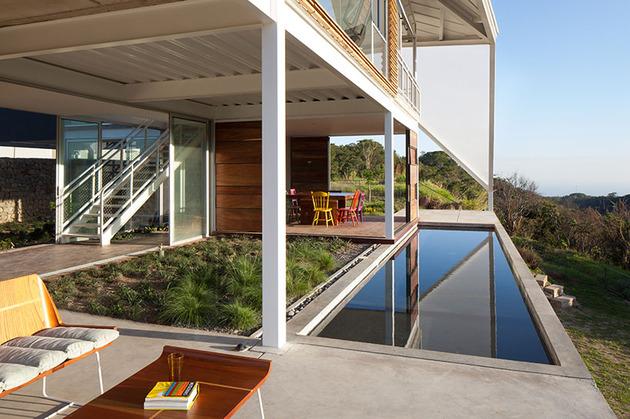 outdoor-living-house-under-geometric-canopy-8-deck-garden.jpg