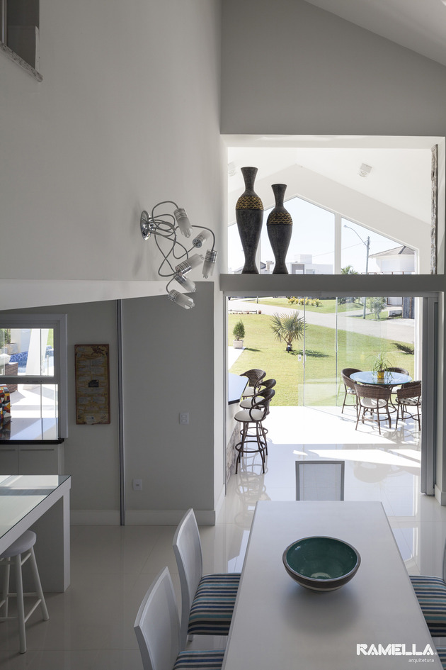 pitched-roofline-house-morphs-angled-facade-10-dining.jpg