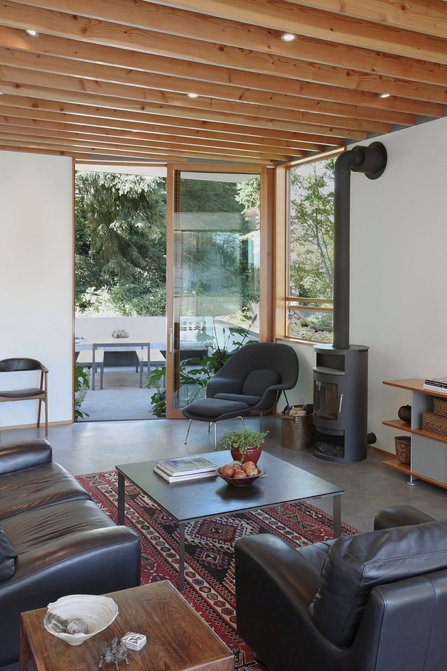 corrugated-steel-house-with-warm-wood-details-throughout-7.jpg
