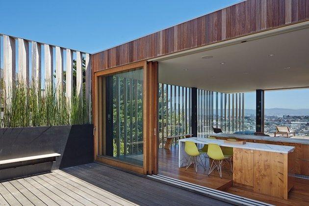 garage-upper-deck-connects-glass-home-slope-10-kitchen.jpg