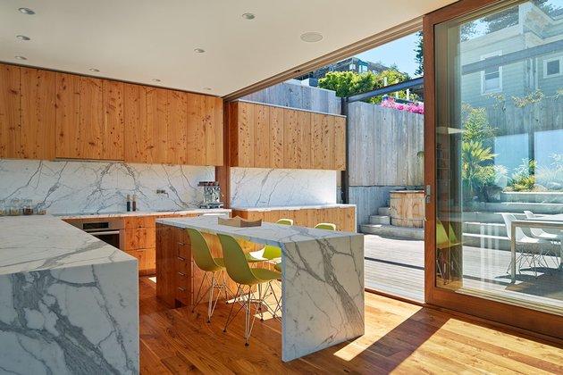 garage-upper-deck-connects-glass-home-slope-12-kitchen.jpg