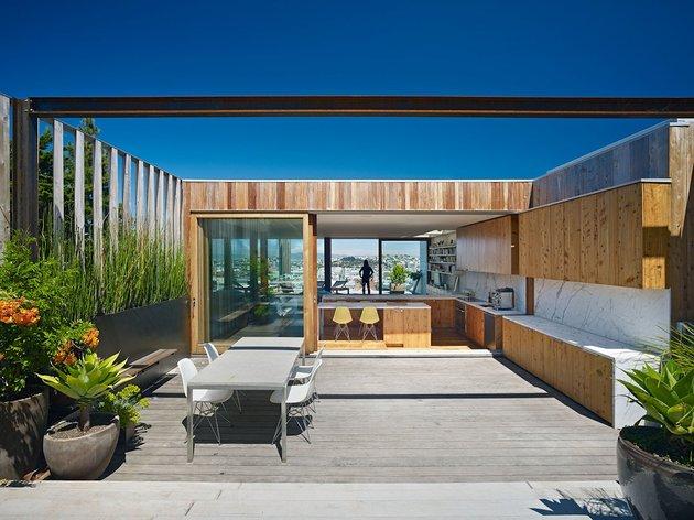 garage-upper-deck-connects-glass-home-slope-9-deck.jpg