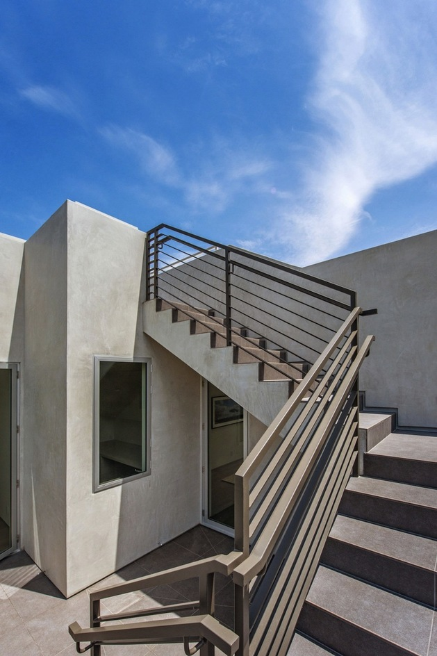 house-with-multilevel-decks-surrounded-by-gardens-15-stairs-to-roof.jpg