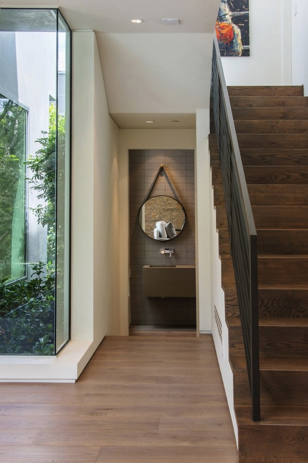house-with-multilevel-decks-surrounded-by-gardens-21-stairs-bathroom.jpg