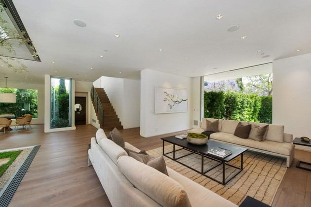 house-with-multilevel-decks-surrounded-by-gardens-25-living-room-stairs.jpg