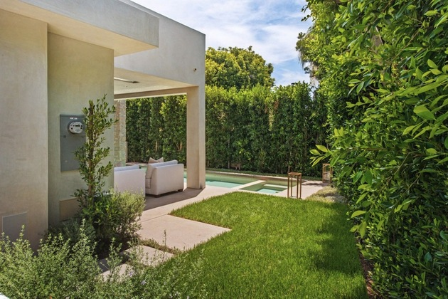 house-with-multilevel-decks-surrounded-by-gardens-4-side-grass.jpg