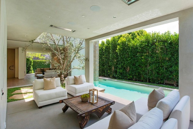 house-with-multilevel-decks-surrounded-by-gardens-8-covered-patio.jpg