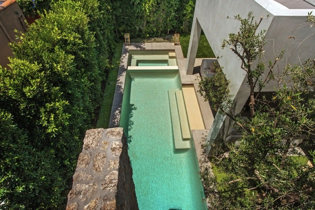 house-with-multilevel-decks-surrounded-by-gardens-9-pool-above.jpg