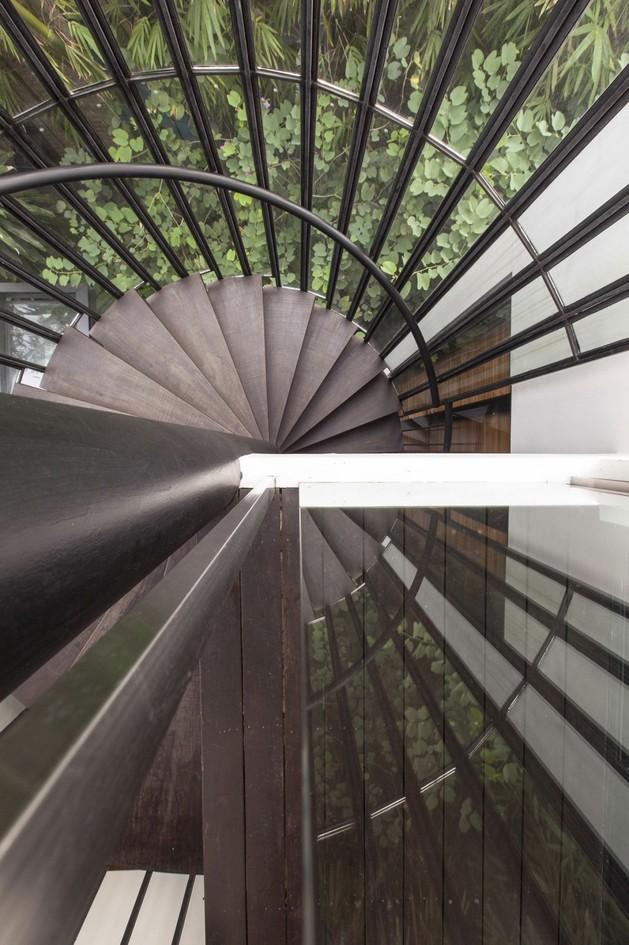 lush-gardens-peekaboo-roof-pool-define-contemporary-home-19-spiral-staircase.jpg