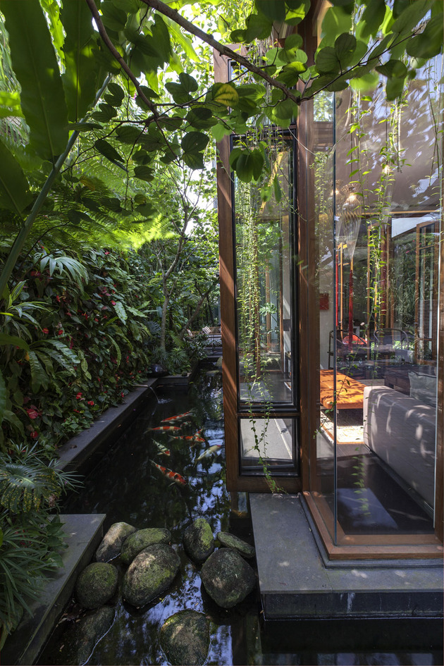 lush-gardens-peekaboo-roof-pool-define-contemporary-home-30-koi.jpg