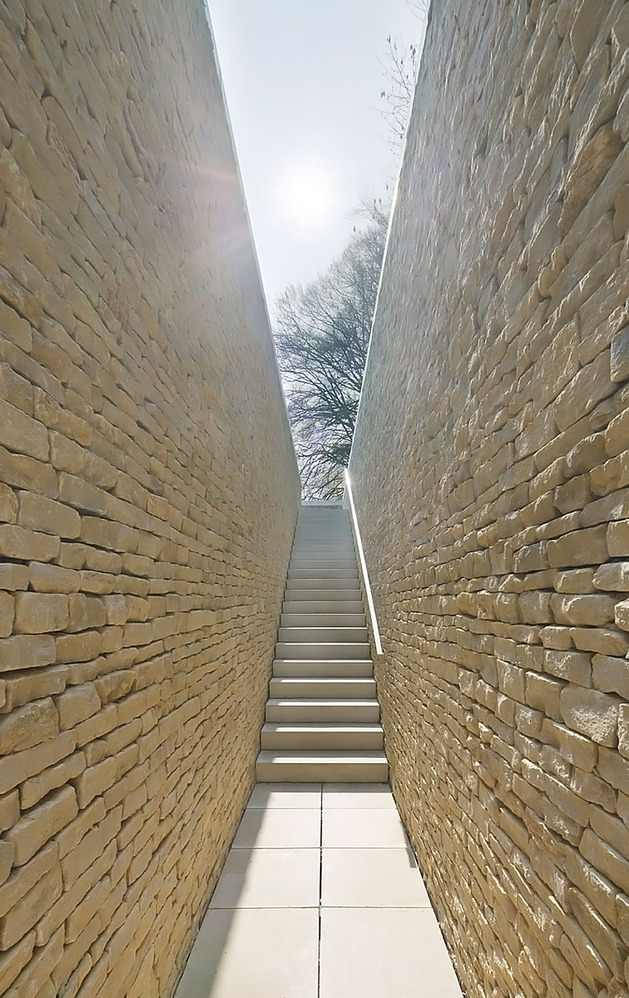 minimal-white-extension-to-traditional-british-home-10-exterior-stairs-down.jpg