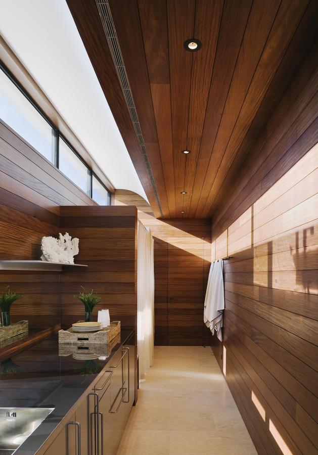 oceanside-home-teak-walls-pool-rooftop-fireplace-10-bath.jpg