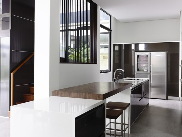 slatted-facade-house-with-sleek-adjoined-apartment-18-kitchen-counter.jpg