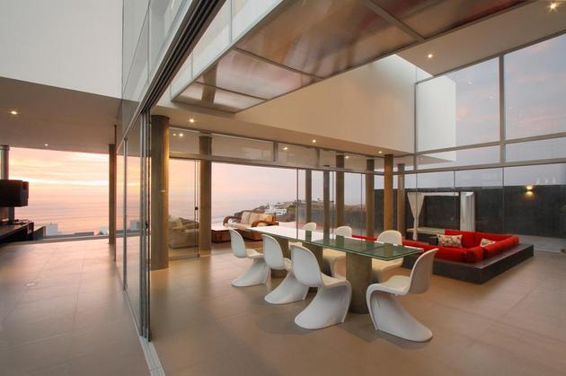 stunning-ultramodern-beach-house-with-glass-walls-10-open-panel-door.jpg