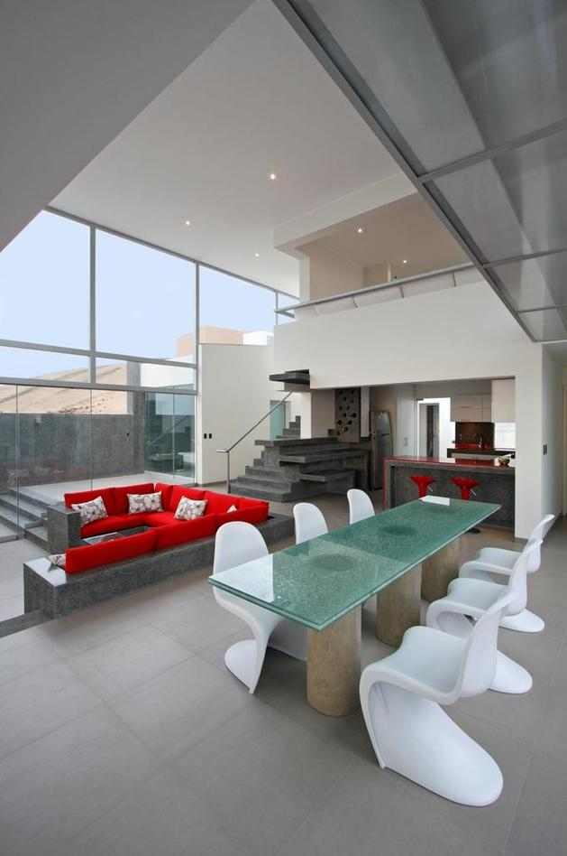 stunning-ultramodern-beach-house-with-glass-walls-13-dining-table-back.jpg