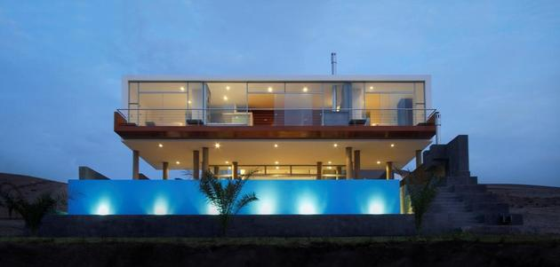 stunning ultramodern beach house with glass walls 2 straight thumb 630xauto 37450 Stunning Ultramodern Beach House With Overflowing Pool