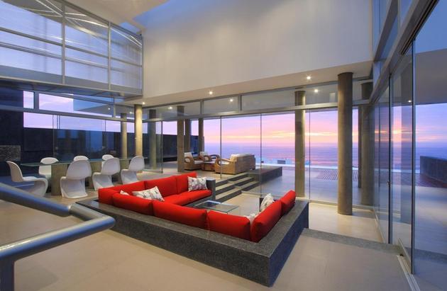 stunning-ultramodern-beach-house-with-glass-walls-7-living-room-evening.jpg