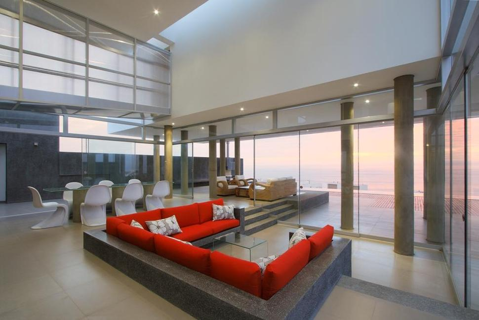 Stunning ultramodern beach house with overflowing pool for Kitchen and living room designs combine