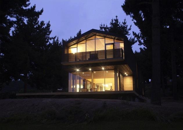 wooden-hilltop-house-sleeps-fourteen-people-4-front-edge-night.jpg