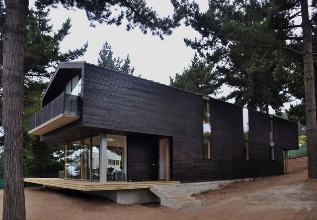 wooden-hilltop-house-sleeps-fourteen-people-5-tall-thin-windows.jpg