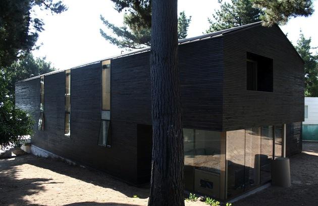 wooden-hilltop-house-sleeps-fourteen-people-7-rear-corner-study-glass.jpg