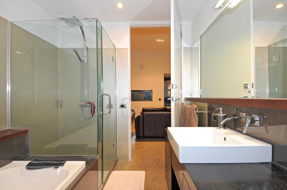 3 glass cubed volumes sheltered under roof define for Room design nz