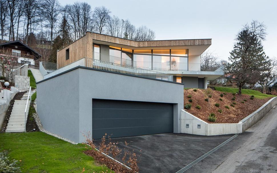 3 storey home on steep slope with grass roofed garage for Building a detached garage on a slope