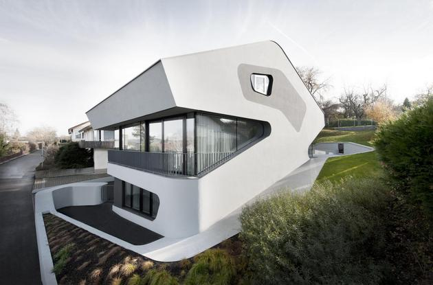 angular modern home features large curvaceous stairwell inside 1 site thumb 630xauto 38683 Angular Modern Home Features Large Curvaceous Stairwell Inside