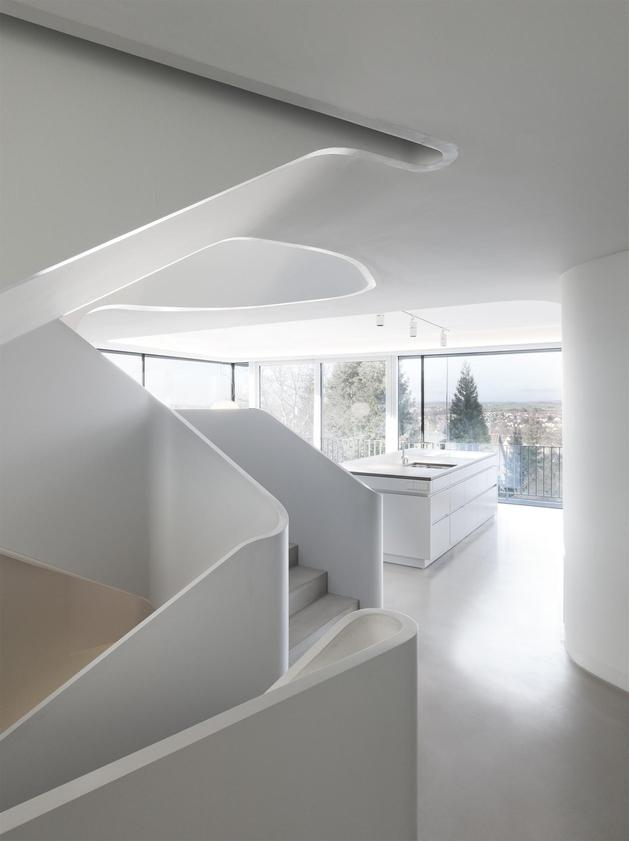 angular-modern-home-features-large-curvaceous-stairwell-inside-12-kitchen.jpg