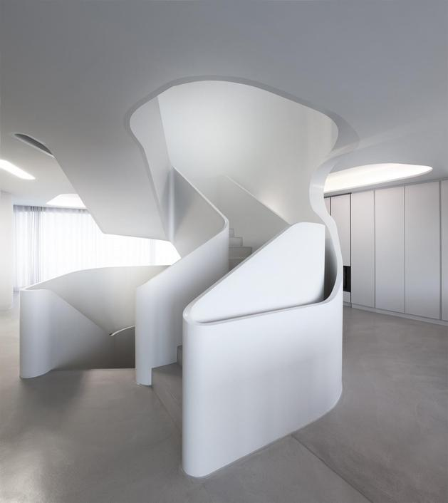 angular-modern-home-features-large-curvaceous-stairwell-inside-13-stairwell.jpg