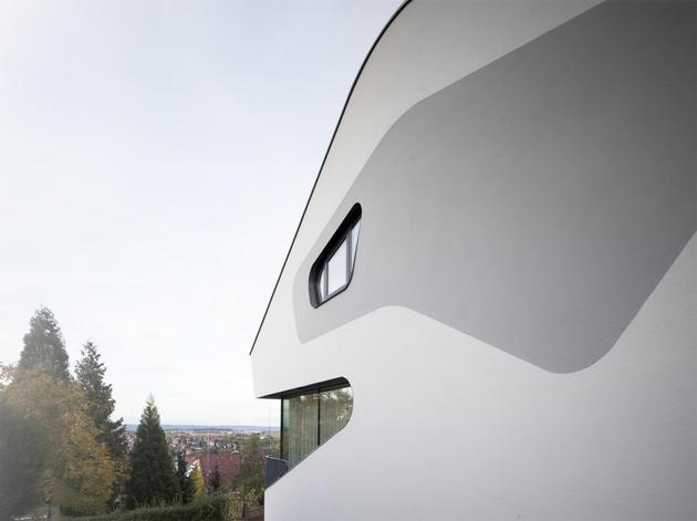 angular-modern-home-features-large-curvaceous-stairwell-inside-17-outside detail.jpg