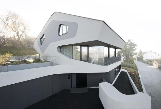 angular modern home features large curvaceous stairwell inside 2 street thumb 630xauto 38685 Angular Modern Home Features Large Curvaceous Stairwell Inside