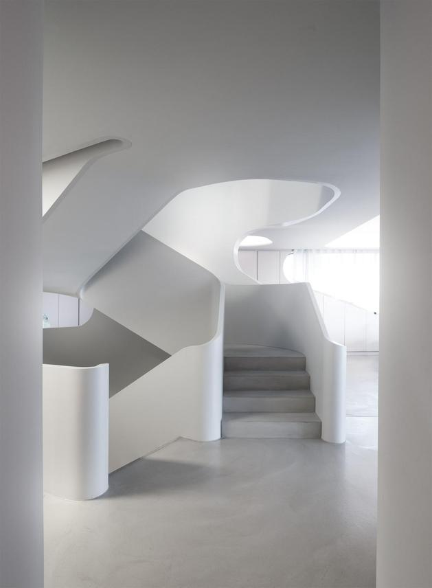 angular-modern-home-features-large-curvaceous-stairwell-inside-7-stairs.jpg