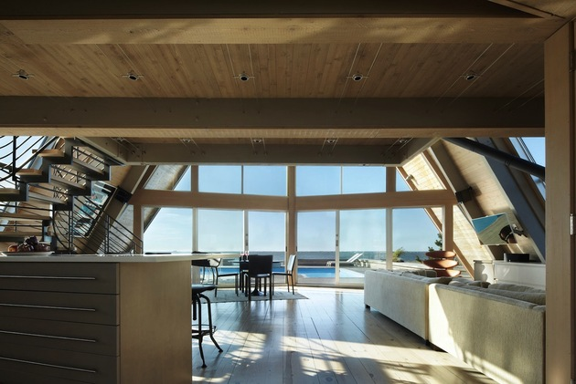 beachfront-a-frame-with-wide-open-interior-15-kitchen-living-room.jpg