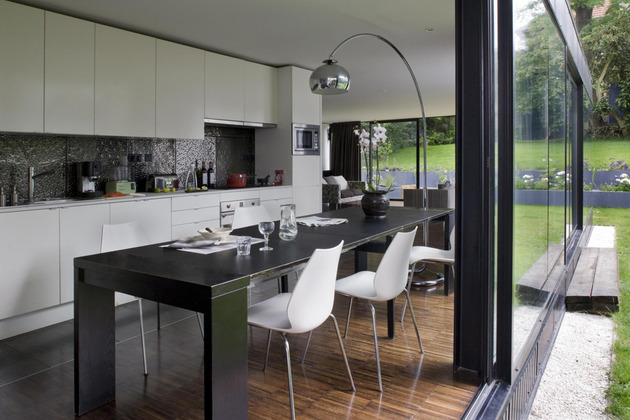 cantilevered-french-house-design-in-wood-and-glass-4.jpg