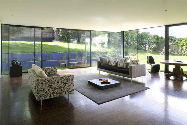 cantilevered-french-house-design-in-wood-and-glass-5.jpg