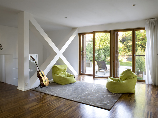 cantilevered-french-house-design-in-wood-and-glass-7.jpg